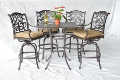 "Mandalay Outdoor Patio 5pc Bar Set Dark Bronze Cast Aluminum, Walnut Cushions. 4 Mandalay Swivel Bar Stools 30""H. 1 Square Bar Table W36""x D36""x H40"". Bar Chair Dimension: Total Size W24"" x D27"" x H49"", Seat Size W19"" x D20"" x H30"". Seat Cushions Included, Walnut Color. Assembly Required."