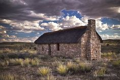 From Times Gone By by Karine Radcliffe An old farmhouse standing alone on the plains of the Khalahari. It has been restored and is now a museum, situated near Twee Rivieren in South Africa's Kgalagadi Transfrontier Park.