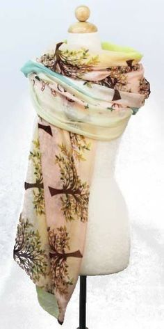 A long and lightweight sheer scarf featuring a tree and skull print. 100% polyester.