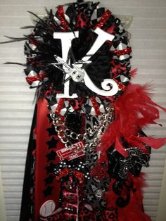 Backing ideas for cute homecoming mums!  Rock n' Roll Homecoming mum