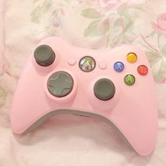 "popfairy: ""I love my pink controller so much. I need a lavender one…. I wish cat noses couldn't turn my xbox off when I'm playing though. Wii, Pink Games, Cat Nose, Video Games Xbox, Gaming Setup, Pink Aesthetic, Video Game Console, Pastel Pink, Xbox One"