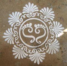 Kolam- I simply love this-- depicts the feet of Lakshmi- the Godess of Wealth @Sarah Therese @Lakshmi Sarkar Devan