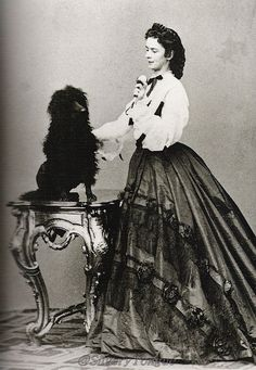 1864: Empress Elisabeth ('Sissi') and dog photographed by Ludwig Angerer.