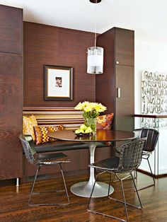 BEAUTIFUL BREAKFAST NOOKS: #wood-paneled dining space with built-in #bench around a #Tulip table