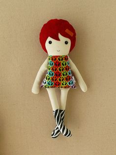 Fabric Doll Rag Doll in Peace Sign Dress with Red Hair and Zebra Boots. $33.00, via Etsy.