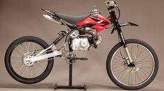 Motoped is a motorized bicycle. Motoped, currently on Kickstarter, is bult from mountain bike and pit bike parts. Motoped uses a Honda pitbike engine and i Motorized Mountain Bike, Mountain Bike Parts, Motorized Bicycle, Mountain Biking, Motocross Bikes, Cool Motorcycles, Motos Honda, Honda Scrambler, Scrambler Motorcycle