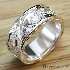 Handmade and engraved 8mm Silver Hawaiian Flat ring.  Engraved with the Old English design which is a gathering of the Hawaiian Plumeria, Maile Leaf