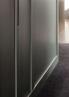 Floor to ceiling custom closets with integrated handles, apt in Paris by Damien Langlois-Meurinne _