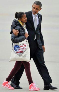 President Barak Obama With Sasha Obama....