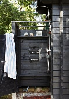 An outdoor shower at an idyllic Swedish cottage with outdoor kitchen and shower. An outdoor shower at an idyllic Swedish cottage with outdoor kitchen and shower.