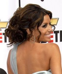 This was a soft and sexy upstyle for Eva from the 2007 NCLR ALMA Awards. Her hair was softly pinned back and loose waves were left out around her face to soften her entire look. Upstyles are a great styling option for anyone after a look which will show off their facial features.