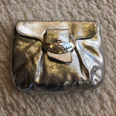 Juicy Silver Metallic Crackle Leather Clutch Juicy Couture Clutch in pristine condition. Seams and shape allow for tons of room as well as three slots inside for cards. Perfect glam clutch goes from casual to evening seamlessly. Juicy Couture Bags