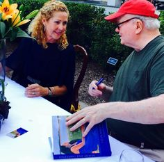 "Pat Conroy signs his foreword in ""Untying the Moon"" alongside debut novelist Ellen Malphrus at the book launch on Oct. 16, 2015 in Bluffton. Her novel is published by Story River Books."