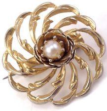 http://www.ebay.com/itm/Vintage-Gold-Tone-Swirl-Flower-Round-Drop-Pearl-Pin-Brooch-Jewelry-/131453639593?pt=LH_DefaultDomain_0&hash=item1e9b3f5ba9