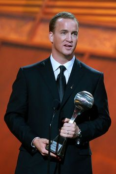 Peyton Manning Photos Photos - NFL player Peyton Manning accepts the award for 'Best Championship Performance' onstage during the 2007 ESPY Awards at the Kodak Theatre on July 2007 in Hollywood, California. - 2007 ESPY Awards - Show Mad Love, Girls Football Boots, Football Boys, Peyton Manning Colts, Manning Nfl, Terrell Davis, Espy Awards, Bluetick Coonhound, John Elway