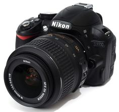 Nikon D3100.  An upgrade from my iphone camera....Which is currently our main camera.