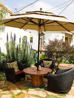 Cable spool table. >> 10 Just-a-Bit Bohemian Outdoor Spaces — House Tour Roundup | Apartment Therapy