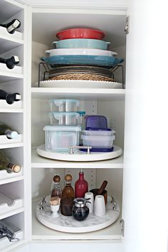 Organize seemingly random items, and you might find they all have a lot more in common than you realized (bakeware, tupperware, and condiments!). Lazy Susans make sure nothing gets pushed into the back and forgotten. See more at I Heart Organizing »   - HouseBeautiful.com