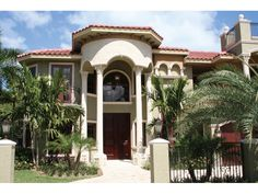 Port Seawall Luxury Home Spanish Stucco Home With Intricate Iron Details from houseplansandmore.com