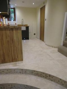 underfloor heating and check out those curves, solid oak worktops.