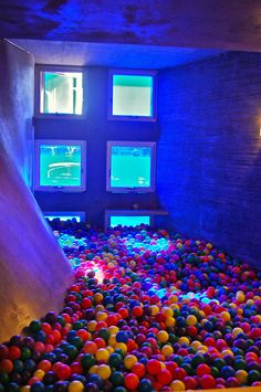 I ahve always wanted a slide into a ball pit room.  The pool in the background isn't bad either.
