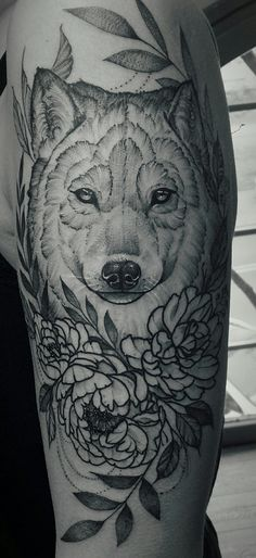 Gray wolf tattoo