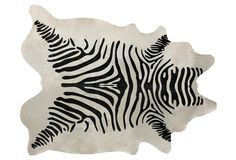 Instantly update your home office with this boldly black and white cowhide rug!