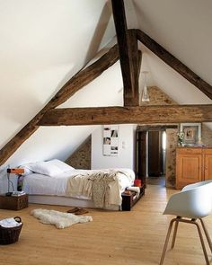 Gorgeous bedroom design? Yes, definitely. Those heavy beams overhead. Not so much. They contribute to headaches and arguments. Paint the beams the same color as the walls + the ceiling and feel the weight lifted...instantly.