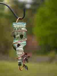 Hummingbird feeders: yet another use for all of my empty beer bottles.