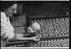 Dolly Mixture :: Worker assembling dolls [the eyes], 1958