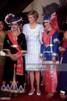 The Princess of Wales with ladies dressed in traditional costume at Tamrin Mini, Jakarta, during an official visit to Indonesia, November 1989. The Princess is wearing a suit by Catherine Walker.