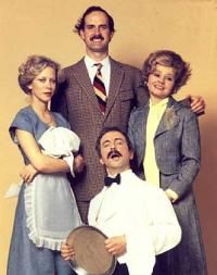 Fawlty Towers....  Basil and Sybil!  So, okay, it's not a movie but it's a tv show.