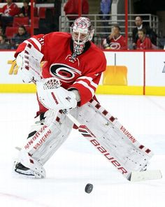 RALEIGH, NC - DECEMBER 26: Cam Ward #30 of the Carolina Hurricanes leaves the crease to play the puck during an NHL game against the New Jersey Devils at PNC Arena on December 26, 2015 in Raleigh, North Carolina. (Photo by Gregg Forwerck/NHLI via Getty Images)