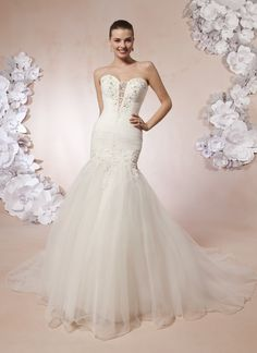 Sweetheart Gowns sweetheart style 5999 A sweetheart neckline with a beaded sheer panel on this rushed dropped  waist tulle mermaid. The deep V-back neckline with beaded lace appliqu�s  and buttons cover the zipper. This style has a chapel length train.