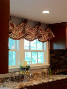 Custom Window Treatments by Windows Etc., Inc., Oswego, IL.....Kitchen Valance, trimmed at bottom edge, mounted with decorative Medallions.