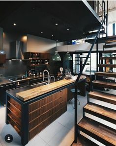 Industrial kitchen with rustic wooden elements and thick industrial metal staircase - modern interior design - ideas - Küche
