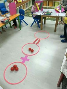 add and subtraction on the floor with hula hoops and balls
