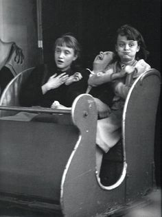 """""""The ghost train""""  1953  Robert Doisneau This is fantastic, I love the girl in the middle, that's totally me after a haunted house!!"""