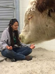 Ellie praying with Dudley before surgery. Gorgeous. Dudley's hoof fell off due to being tangled in bale twine at an awful ranch. The Gentle Barn
