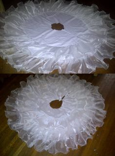 This is my new tree skirt that I made from an old wedding dress that I got for free. I paid two dollars for the fabric to use for the backing. I used my hot glue gun to put it all together.