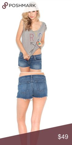 "J Brand Cut off Short These cool cut-off denim shorts are crafted with a lean yet relaxed fit for an effortlessly flattering staple on weekend days. Belt loops and button at self waist. Waist measures 16 1/2"" Zip front. Four-pocket style. Frayed hem. J Brand Shorts Jean Shorts"