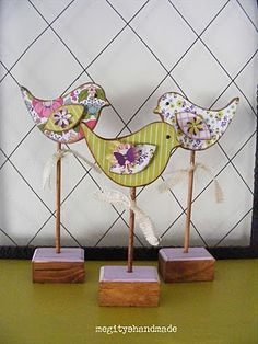 Wooden birds on a stick. Instead use the idea for my cards.