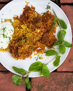 Indian Lamb Biryani: a casserole of tender lamb curry and fragrant saffron rice. A company worthy recipe! Serve with cooling cucumber raita on the side l panningtheglobe.com