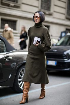 Contemporary and oversized - pair Balenciaga's knitted dress with a pair of Vetements boots and add Loewe's directional sunglasses - as seen on Yoyo Cao at fashion week.