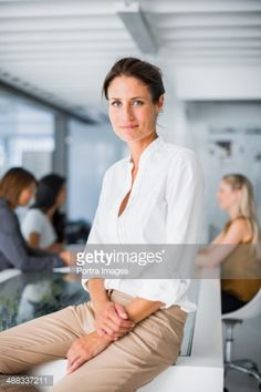 Stock-Foto : Businesswoman sitting on conference table