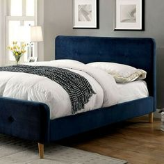 This Kodell Platform Bed (Navy Blue) by Furniture of America features smooth and inviting flannelette upholstery that allows the striking color option to make a statement. Curved corners, button accents and angled legs work together to add a touch of nonc Upholstered Bed Frame, Upholstered Platform Bed, Platform Beds, Queen Bedding Sets, Queen Beds, Blue Bedding, Blue Headboard, Headboard Ideas, Adjustable Beds