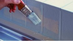 How to paint tiles. I think painting the tiles in the bathroom would be cheaper than retiling.