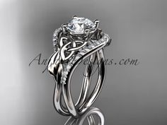 Find the Unique Diamond Engagement rings, diamond wedding bands, diamonds online at anjaysdesigns.com Free shipping. platinum diamond celtic trinity knot wedding ring, engagement ring CT7244