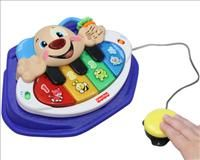 Piano Puppy @ Enabling Devices - Bilingual! We've adapted Piano Puppy, placed it in a sturdy mold, and angled it for easy access. With 12 different children's songs and three modes of play, your child will have hours of fun.