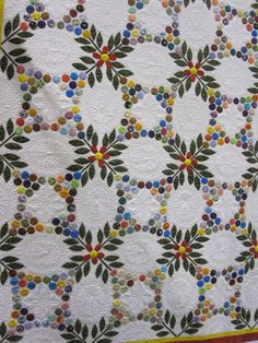 True Blue Canadian: Kawartha Quiltmakers' Guild Quilt Show - Part two - pretty applique, slightly different use of yo-yos